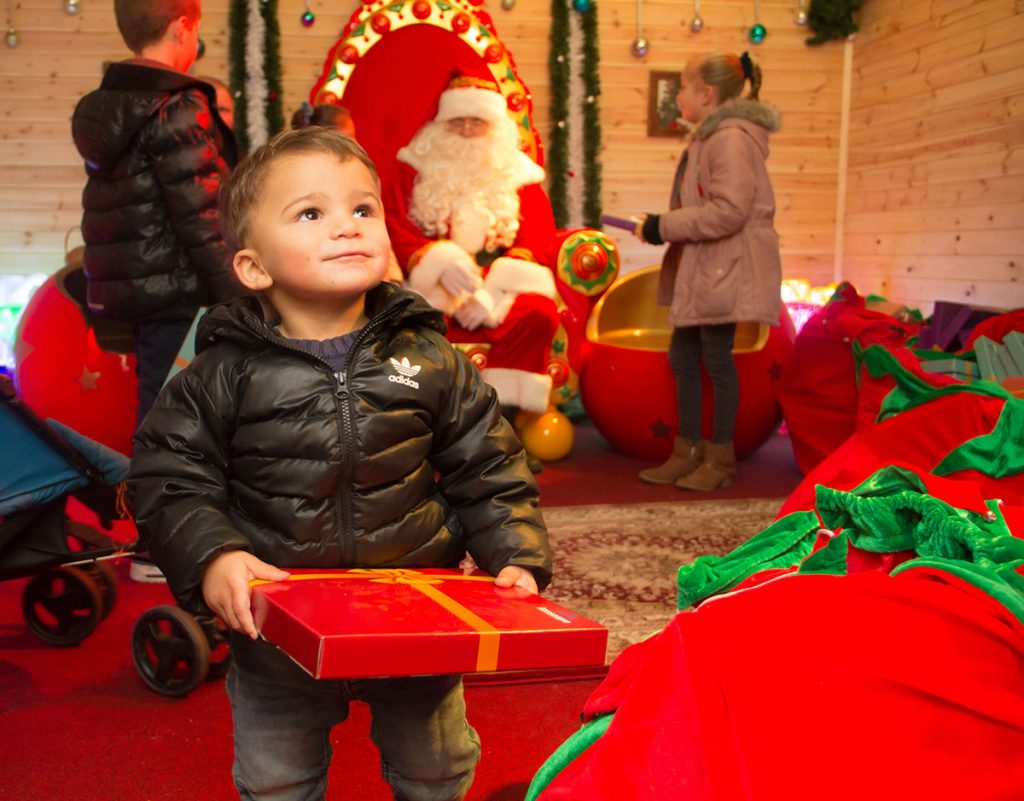 Child with gift at Santa's Grotto